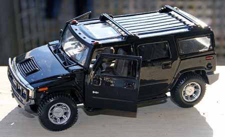 Now this is a real redemption game prize. ten buckat the boardwalk gets you a metal replica of a Hummer plus sa bunch of little trinkets