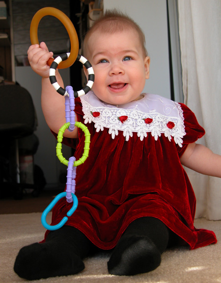 Homemade teether in a chain with store bought ones. She could switch back and forth depending on her mood.
