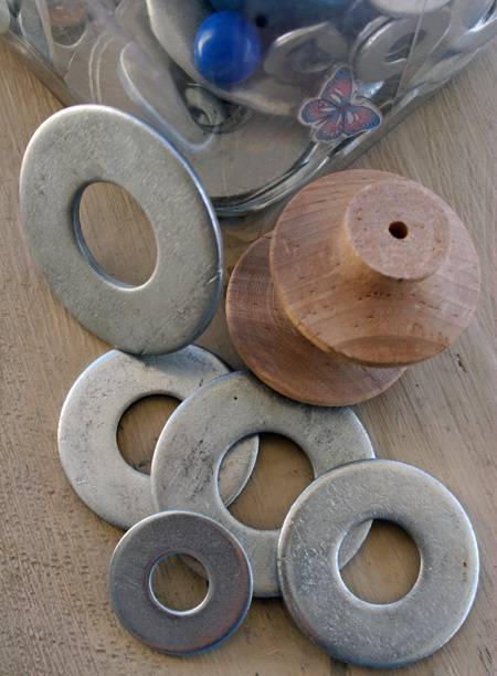 Big washers and wooden drawer knobs make for great durable toys.